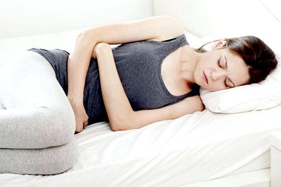 Боль внизу живота у женщин, причины тянущих, ноющих болей
